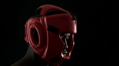 Tough boxer wearing red helmet Stock Footage