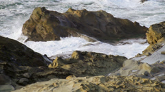 Slow motion water between rocks Stock Footage