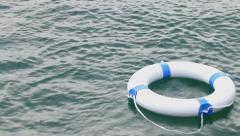 If you see someone in the water throw the lifebuoy - stock footage