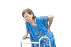 Asian senior woman holding her walker with back pain. Stock Photos