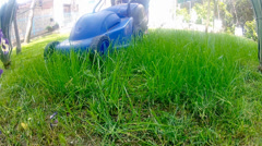 Mow lawn grass cutter in yard. Stock Footage