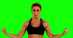 Super fit woman flexing her arms Stock Footage