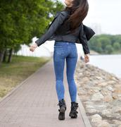 Beautiful female ass in blue jeans Stock Photos