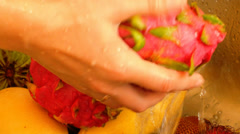Washing Vivid and Vibrant Dragon Fruit or Pitaya. Exotic and Tropical Fruits in Stock Footage
