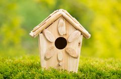 new wooden birdhouse outdoors during daytime - stock photo