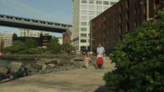 Brooklyn Bridge Park in summer. Tourists and families in DUMBO in summer. 4K. Stock Footage