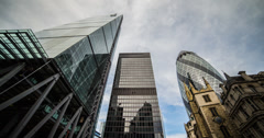 4K time lapse looking up at the London Financial District skyscrapers Stock Footage