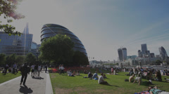 Londoners Relaxing with City Hall Stock Footage