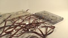 Broken Audio Cassettes Isolated On White, Loose Tape, Retro, Media, Pan Shot Stock Footage