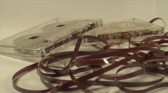 Broken Audio Cassettes Isolated On White, Loose Tape, Retro, Close Up Pan Shot Stock Footage