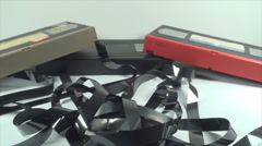 Broken VHS Cassettes, Loose Tape, Isolated On White, Retro, Media, Pan Shot Stock Footage