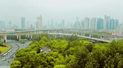 Timelapse of busy traffic over overpass in modern city , Shanghai, China - stock footage