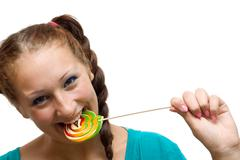 Woman with lolipop Stock Photos