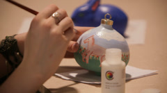 Hand painted with a Christmas toy Stock Footage