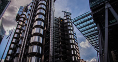 4K time lapse of clouds passing over the Lloyd's of London building in the City - stock footage