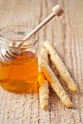 grissini with sesame seeds and honey - stock photo