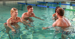 Fit people doing an aqua aerobics class in swimming pool Stock Footage