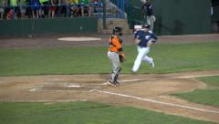 3 Baseball Players Run Across Home Plate Stock Footage