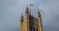 4K time lapse of London's Parliament with the Union Jack Flag flying high Stock Footage