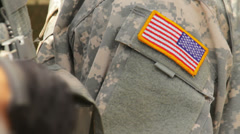 American flag on the camouflage uniform, US soldier Stock Footage