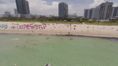 Umbrellas on the beach aerial video Stock Footage