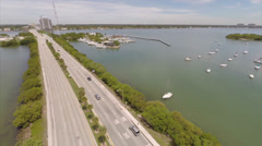 Aerial video JFK highway and sail boats Stock Footage