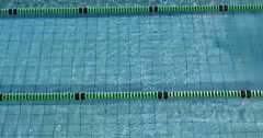 Fit woman doing the butterfly stroke in swimming pool Stock Footage