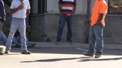 Hispanic day laborers waiting - stock footage