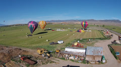 Aerial farm shed hot air balloon landing field HD 063 Stock Footage