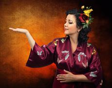Stock Photo of kimono caucasian woman extending her right arm