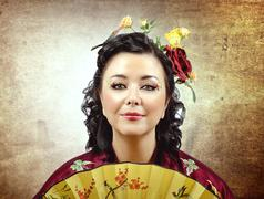 Stock Photo of face portrait of a stylized kimono woman with fan