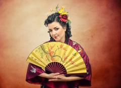 Stock Photo of portrait of kimono white mature woman with fan