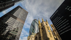 HD time lapse of clouds passing over the Gherkin near Leadenhall Street, London Stock Footage