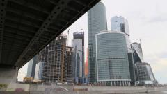 Ship float under bridge and constructed office skyscrapers on the river. Moscow Stock Footage