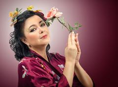 Stock Photo of kimono caucasian woman holding pink rose