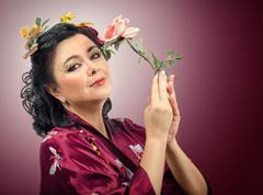 kimono caucasian woman holding pink rose - stock photo