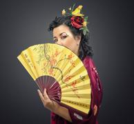 Stock Photo of kimono white woman holding traditional fan