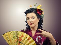 Stock Photo of flowers haired kimono woman doing cool hand gesture