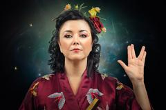 Stock Photo of kimono woman showing spoke sign
