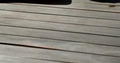 Sexy brunette lying poolside sunbathing Stock Footage