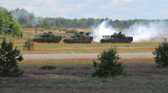Armored fighting vehicles against smoke background in the field, position Stock Footage