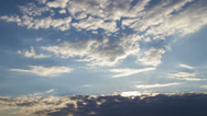 Stock Video Footage of cumulus and cirrus clouds at sunset