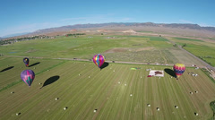 Aerial farm land rural hot air balloons landing HD 055 Stock Footage