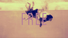 Two girls diving into swimming pool in evening dresses with free text Stock Footage