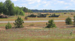 Armored fighting vehicles prepare for attack in the field during their mission  Stock Footage