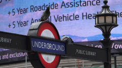 Pidgeons on London Undergound sign Picadilly Circus Stock Footage