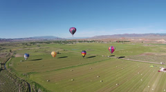Aerial rural farm field hot air balloons landing HD 054 Stock Footage