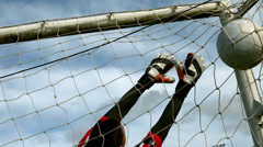 Goalkeeper in red letting in a goal during a game Stock Footage