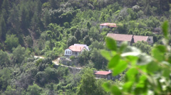 Houses on side of a hill in Pedoulas village Stock Footage