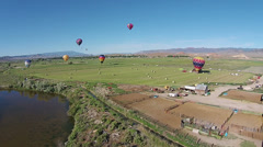 Aerial hot air balloons rural farm field landing HD 052 Stock Footage